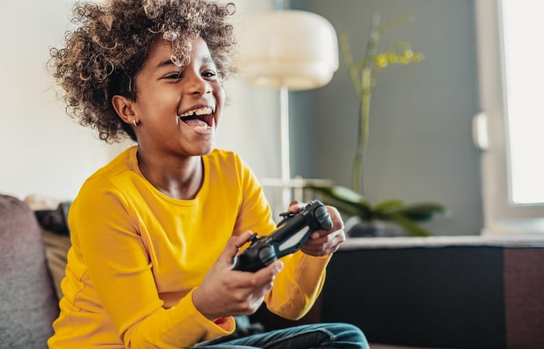 Kid playing on the PlayStation header banner
