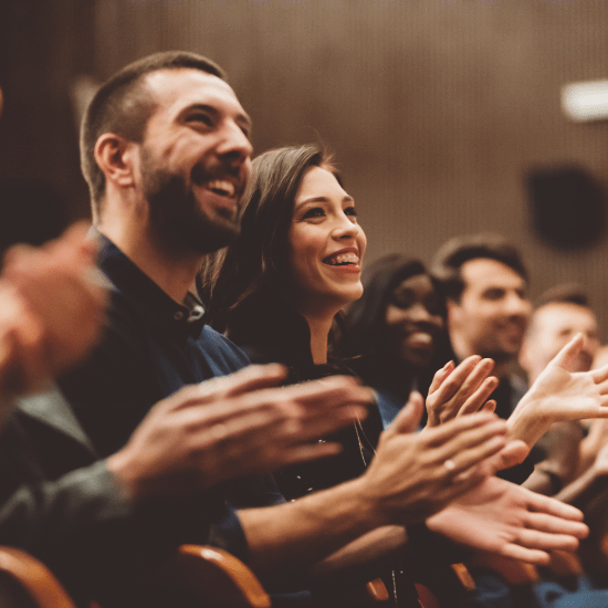 An audience clapping